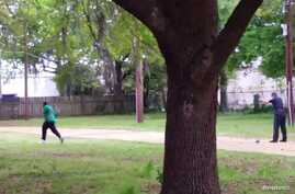North Charleston police officer Michael Slager (R) is seen allegedly shooting 50-year-old Walter Scott in the back as he runs away, in this still image from video in North Charleston, South Carolina taken April 4, 2015.