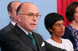 French Prime Minister Bernard Cazeneuve (L), flanked by Ericka Bareigts (R) Minister for France's overseas territories, makes a statement after a meeting on protests in the overseas French department of Guiana, in Paris, France, April 3, 2017.