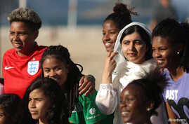 Nobel Peace Prize winner Malala Yousafzai is pictured with teenage girls from Complexo da Penha, who work with football organization Street Child United, at Copacabana beach in Rio de Janeiro, Brazil July 11, 2018.