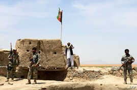 Afghan Border Police personnel keep watch during an ongoing battle between Pakistani and Afghan Border forces near the Durand line at Spin Boldak, in southern Kandahar province, May 5, 2017.