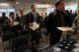 Veterans wait to speak to a representative from Securitas during a job fair at Yankee Stadium in the Bronx borough of New York, September 28, 2012.