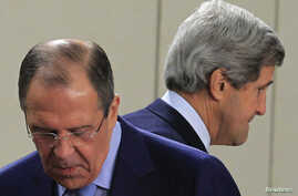 U.S. Secretary of State John Kerry (R) walks behind Russian Foreign Minister Sergei Lavrov (L) at the start of a NATO-Russia foreign ministers meeting in Brussels April 23, 2013.
