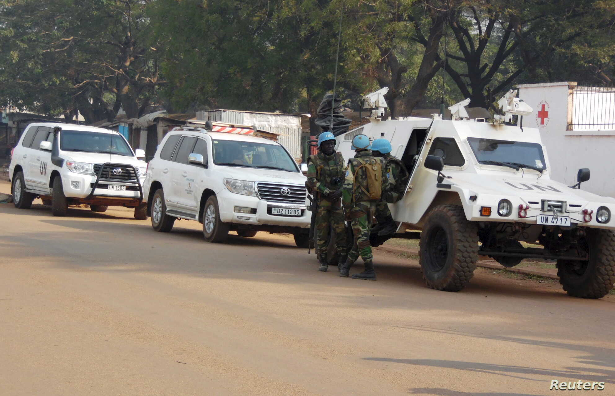 FILE - U.N. peacekeepers take a break as they patrol along a street during the presidential election in Bangui, the capital of Central African Republic, Dec. 30, 2015.