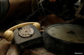 A rotary dial telephone set and clock are seen in the NATO tunnels dating back to the Cold War in the War Headquarters tunnels beneath Valletta, Malta, March 28, 2017.