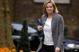 FILE - Amber Rudd, Britain's Home Secretary, arrives for a cabinet meeting at Downing Street, London, March 29, 2017.