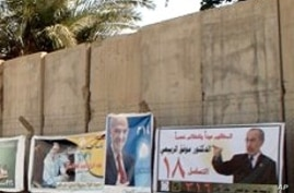 Campaign posters line a concrete blast wall in Baghdad ahead of Sunday's national elections, 06 Mar 2010