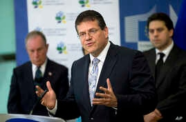 FILE - European Union Vice President Maros Sefcovic, center, speaks during a media conference at EU headquarters in Brussels, June 22, 2016