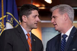 Speaker of the House Paul Ryan, R-Wis., left, confers with House Majority Leader Kevin McCarthy, R-Calif., during a news conference on Capitol Hill in Washington, May 16, 2018. The GOP leadership praised the work of the Agriculture Committee in craft