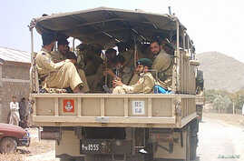Pakistani paramilitary soldiers patrol in Malikhel village near Parachinar, the main town of the Kurrum region on the Afghan border, about 265 km (165 miles) from Islamabad, June 2006 file photo.