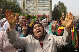Protesters chant slogans as they protest Saturday's bombing attacks, during a rally in Ankara, Turkey, Sunday, Oct. 11, 2015.