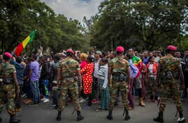 Ethiopian army soldiers attempt to control protestors from the capital and those displaced by ethnic-based violence over the weekend in Burayu, as they demonstrate to demand justice from the government in Addis Ababa, Ethiopia, Sept. 17, 2018.