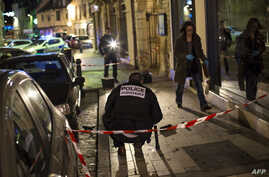 "Policemen collect evidence on Dec. 21, 2014 in Dijon on the site where a driver shouting ""Allahu Akbar"" (""God is great"") drove into a crowd injuring 11 people, two seriously."