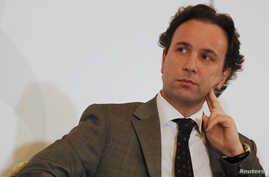 FILE - Khaled Khoja, a Syrian National Council (SNC) member, attends the Syrian Business Forum in Doha.