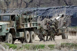 South Korean soldiers prepare 155 mm howitzers during their military exercise in the border city between two Koreas, Paju, north of Seoul, South Korea, April 18, 2013.