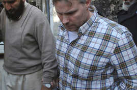 US Official Held in Pakistan for Double Killing