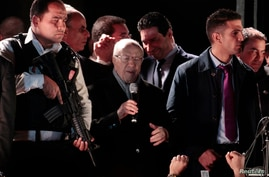 Beji Caid Essebsi, center, leader of the Nidaa Tounes party, speaks outside the party's headquarters in Tunis, Dec. 21, 2014.