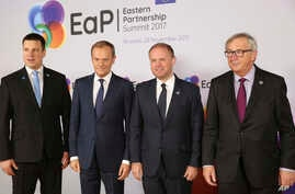 FILE - Malta's Prime Minister Joseph Muscat, second right, is welcomed by, from left, Estonian Prime Minister Juri Ratas, European Council President Donald Tusk and European Commission President Jean-Claude Juncker during arrivals for an Eastern Part