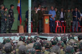 President Rodrigo Duterte cheers as he declares the liberation of Marawi city after an almost five-months long battle to oust Islamic State fighters from the city, in Marawi, Philippines, Oct. 17, 2017.