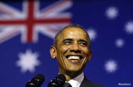 President Barack Obama smiles broadly as he takes the stage to speak at the University of Queensland in Brisbane, Australia, Nov. 15, 2014. Obama is in Brisbane for the G20 Summit.