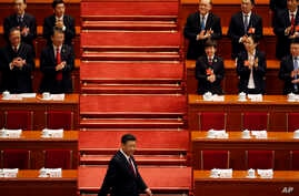 Chinese President Xi Jinping arrives for the opening session of the annual National People's Congress in Beijing's Great Hall of the People, March 5, 2018.