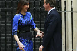 Samantha Cameron congratulates Britain's Prime Minister David Cameron after his speech outside Number 10 Downing Street announcing that he would would form a new majority goverment in London, Britain May 8, 2015. Cameron won a stunning election victo...