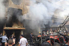 In this photo released by the Syrian official news agency SANA, Syrian citizens gather in front of a damaged building that was destroyed by a car bomb, at Jaramana neighborhood, in Damascus, Syria, Monday Oct. 29, 2012.