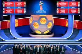 The coaches of the qualified teams pose for a group photo at the end of the 2018 soccer World Cup draw in the Kremlin in Moscow, Dec. 1, 2017.
