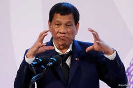 FILE - Philippines' President Rodrigo Duterte gestures during a news conference on the sidelines of the Association of South East Asian Nations summit in Pasay, metro Manila, Philippines, Nov. 14, 2017. Duterte has ended peace talks with Maoist-led r