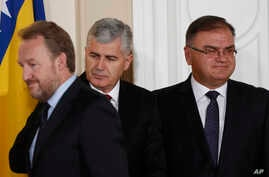 FILE - Members of Bosnia's tripartite presidency, Muslim Bosniak member, Bakir Izetbegovic (L), Croat member Dragan Covic (C) and Serb member, Mladen Ivanic, are seen at the presidency's inauguration ceremony in Sarajevo, Bosnia, Nov. 17, 2014.