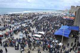 Libyan residents gather near the courthouse in Benghazi, Libya, February 23, 2011
