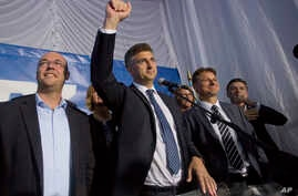 Andrej Plenkovic, center, leader of center-right HDZ party celebrates elections results at the party's headquarters in Zagreb, Croatia, early Sept. 12, 2016.
