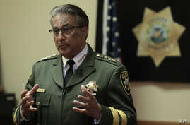 FILE - San Francisco Sheriff Ross Mirkarimi gestures during an interview, July 6, 2015, in San Francisco.