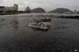 Rio Olympics Filthy Water: Thrash floats on the water of Botafogo beach next to the Sugar Loaf mountain and the Guanabara Bay where sailing athletes will compete during the 2016 Summer Olympics in Rio de Janeiro, Brazil, Saturday, July 30, 2016.