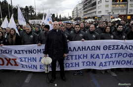 Police officers take part in a rally of uniformed staff of the public sector as they protest against planned pension reforms in central Athens, Greece, Feb. 5, 2016.
