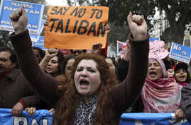 Supporters of Pakistani civil society groups rally against Taliban and militants in Lahore, Pakistan. Monday, Jan. 5, 2015.