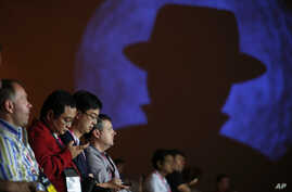 FILE - People attend a presentation on hacking a city during the Black Hat conference, Aug. 6, 2015, in Las Vegas. The annual computer security conference draws thousands of hackers and security professionals to Las Vegas.