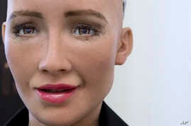 """FILE - Hanson Robotics' flagship robot, Sophia, is pictured in Hong Kong, Sept. 28, 2017. Founder David Hanson envisions a future in which AI-powered robots evolve to become """"super-intelligent genius machines."""""""