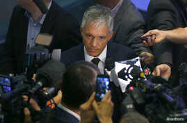 Swiss Attorney General Michael Lauber, center, speaks to media following a news conference in Bern, Switzerland, June 17, 2015.