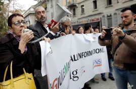 Journalists stage a protest, Nov. 13, 2018 in Milan and across Italy against insults from prominent figures in the governing 5-Star Movement.