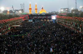 Shi'ite faithful pilgrims gather between, the holy shrine of Imam Abbas and the holy shrine of Imam Hussein, in the background, for Arbaeen in Karbala, 50 miles (80 kilometers) south of Baghdad, Iraq, Nov. 19, 2016.