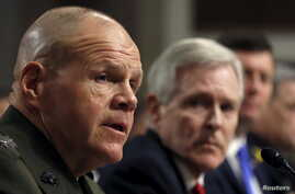 Commandant of the U.S. Marine Corps Gen. Robert Neller (L) testifies during a Senate Armed Services Committee hearing on the implementation of the decision to open all ground combat units to women on Capitol Hill in Washington, Feb. 2, 2016.