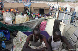 Displaced men rest in an improvised shelter at Tomping camp, where some 17,000 displaced people who fled their homes after violence erupted in South Sudan's capital Juba in mid-December are being sheltered by the United Nations, in Juba Jan. 10, 2014