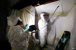Asbestos Removal Technologies Inc. technicians are seen performing asbestos abatement in Howell, Michigan, Oct. 18, 2017.