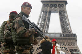 "French soldiers patrol near the Eiffel Tower in Paris as part of the highest level of ""Vigipirate"" security plan after a shooting at the Paris offices of Charlie Hebdo, Jan. 9, 2015."
