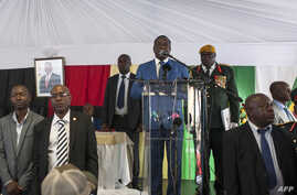 Zimbabwean President Emmerson Mnangagwa delivers a speech during a rally with Zimbabwean businessmen and foreign investors at the Zimbabwean embassy in Pretoria, South Africa, Dec. 21, 2017.