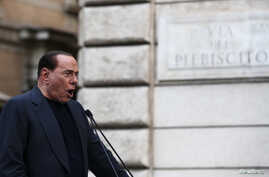 Former Italian Prime Minister Silvio Berlusconi speaks during a rally to protest his tax fraud conviction, outside his palace in central Rome, August 4, 2013.
