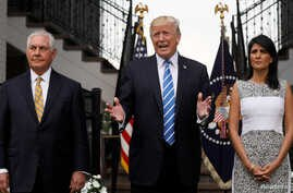 U.S. President Donald Trump, flanked by Secretary of State Rex Tillerson, left, and U.S. Ambassador to the United Nations Nikki Haley, speaks to reporters after their meeting at Trump's golf estate in Bedminster, New Jersey, Aug. 11, 2017.