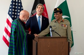 U.S. Secretary of State John Kerry (C) laughs as Afghan President Hamid Karzai and Pakistani Army Chief General Ashfaq Parvez Kayani shake hands after he made a statement following a meeting in Brussels April 24, 2013. U.S.-hosted talks between Karza