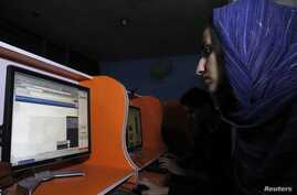 An Afghan woman browses the YouTube website at a public internet cafe in Kabul. Like Afghanistan, Indonesia seeks to ban the YouTube website showing a U.S.-made film insulting the Prophet Mohammad that sparked protests in North Africa and the killing