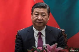 China's President Xi Jinping looks on during a signing meeting with Maldives President Abdulla Yameen at the Great Hall of the People in Beijing, Dec. 7, 2017.